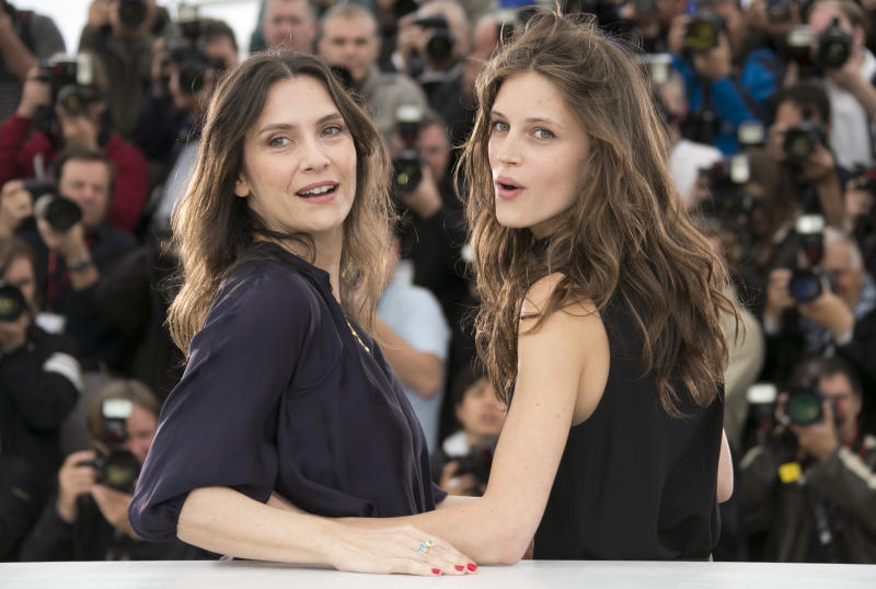 Actors Geraldine Pailhas, left, and Marine Vacth pose for photographers during a photo call for the film Young & Beautiful at the 66th international film festival, in Cannes, southern France, Thursday, May 16, 2013. (AP Photo/Francois Mori)