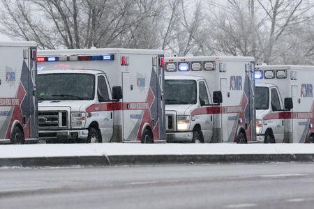 Ambulances wait on a road leading to a Planned Parenthood center after reports of an active shooter in Colorado Springs, November 27, 2015. REUTERS/Isaiah J. Downing