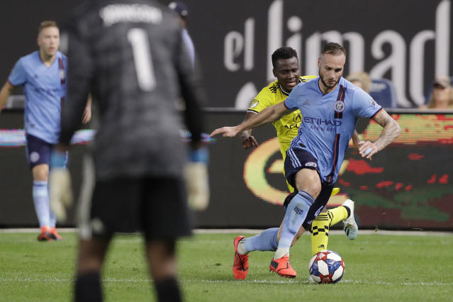 New York City FC defender Maxime Chanot, right, keeps the ball from Columbus Crew forward David Accam, second from right, near New York's goal, tended by New York City FC goalkeeper Sean Johnson (1) during the second half of an MLS soccer match, Wednesday, Aug. 21, 2019, in New York. New York City FC defeated Columbus 1-0. (AP Photo/Kathy Willens)