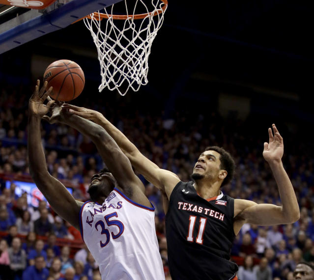 "Kansas' <a class=""link rapid-noclick-resp"" href=""/ncaab/players/136069/"" data-ylk=""slk:Udoka Azubuike"">Udoka Azubuike</a> (35) is fouled by Texas Tech's <a class=""link rapid-noclick-resp"" href=""/ncaaf/players/273347/"" data-ylk=""slk:Zach Smith"">Zach Smith</a> (11) as he shoots during the first half of an NCAA college basketball game Tuesday, Jan. 2, 2018, in Lawrence, Kan. (AP Photo/Charlie Riedel)"