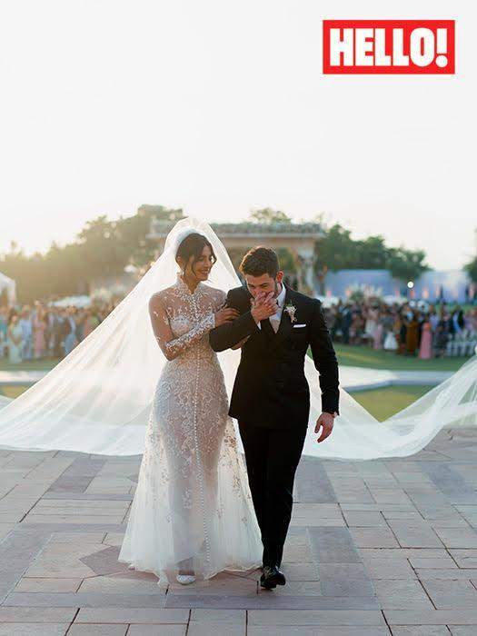 Priyanka Chopra and Nick Jonas (pictured in their 'white wedding' outfits) married in India this weekend. [Photo: Hello! magazine]