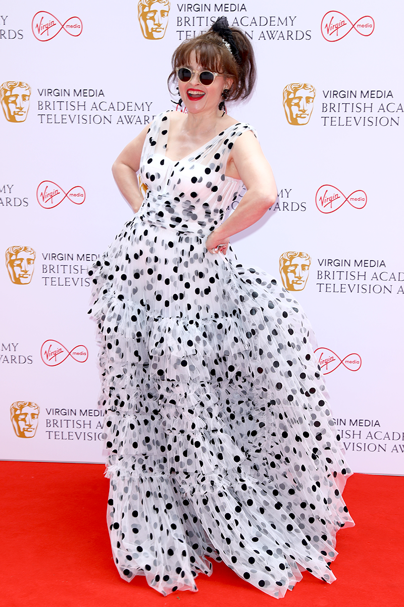 <p>Helena Bonham Carter steps our sporting a frothy, tiered polka dot gown with shades to match.</p>