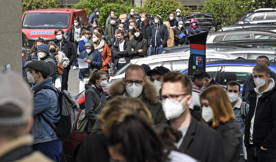 Several hundreds of people line up to receive an AstraZeneca vaccination against the coronavirus at the forum of the DITIB central mosque in Cologne, Germany, Saturday, May 8, 2021. (AP Photo/Martin Meissner)