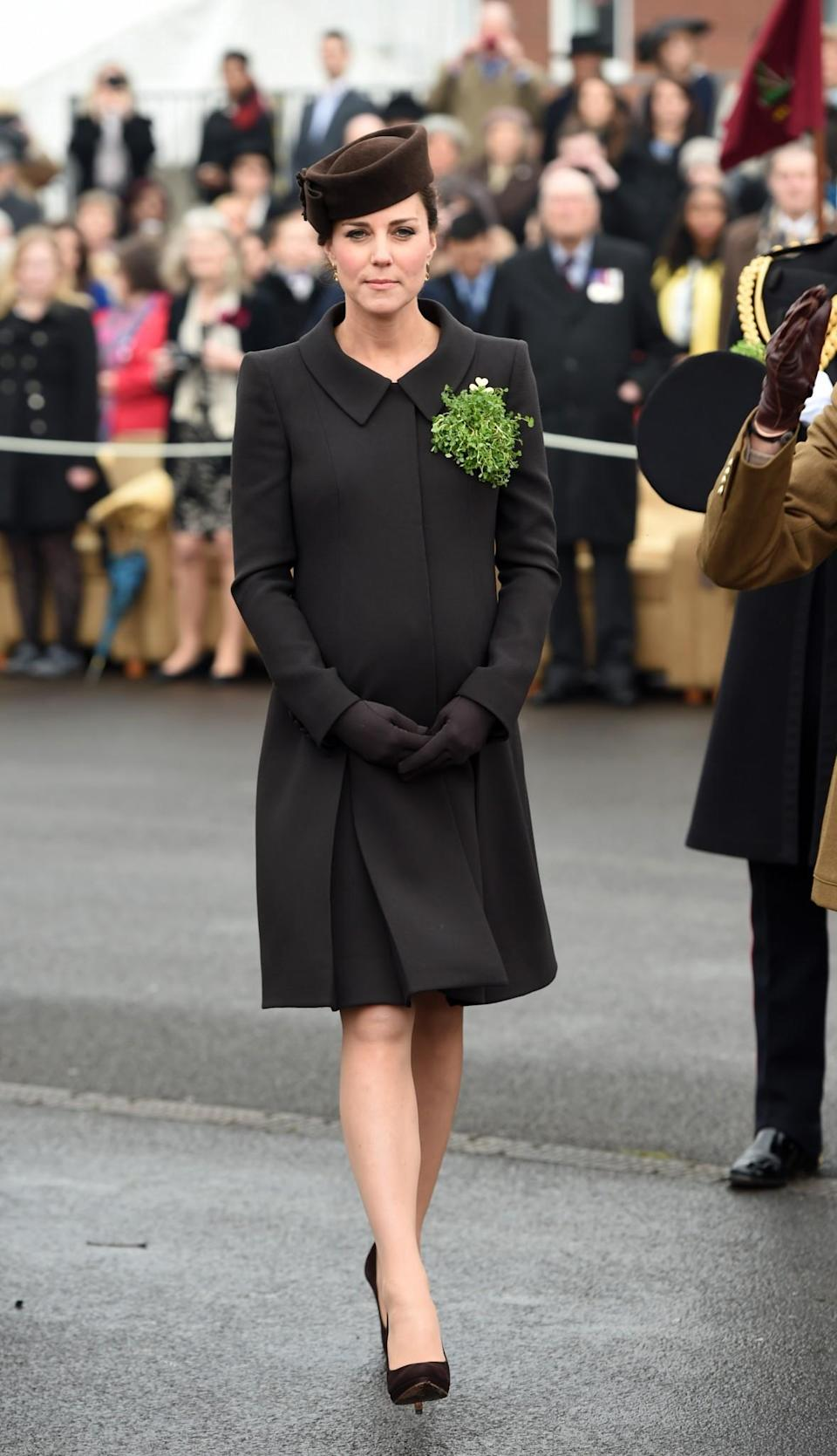 <p>In 2015, Kate was heavily pregnant with Princess Charlotte. Wearing her hair up in a neat chignon, she donned a brown Lock & Co hat (the same exact style she wore in 2012), a brown Catherine Walker coat and matching shoes by Emmy London. <em>[Photo: PA]</em> </p>