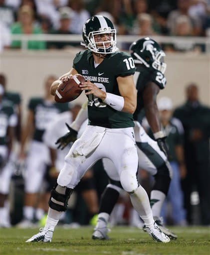 Michigan State quarterback Andrew Maxwell looks for a receiver during the third quarter of an NCAA college football game against Boise State, Friday, Aug. 31, 2012, in East Lansing, Mich. Michigan State won 17-13. (AP Photo/Al Goldis)