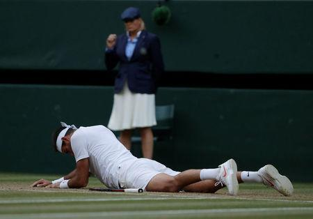 Tennis - Wimbledon - All England Lawn Tennis and Croquet Club, London, Britain - July 11, 2018 Argentina's Juan Martin Del Potro after falling during his quarter final match against Spain's Rafael Nadal REUTERS/Andrew Couldridge