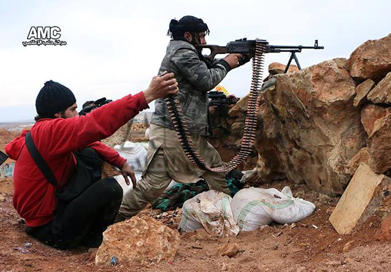This photo provided by the anti-government activist group Aleppo Media Center (AMC), which has been authenticated based on its contents and other AP reporting, shows Syrian rebels firing weapons towards Syrian government troops loyal to President Bashar Assad in Aleppo, Syria, Tuesday, Feb. 25, 2014. The leader of a powerful al-Qaida-linked group in Syria gave a rival breakaway group a five-day ultimatum to accept arbitration by leading clerics to end infighting or be expelled from the region. (AP Photo/Aleppo Media Center AMC)