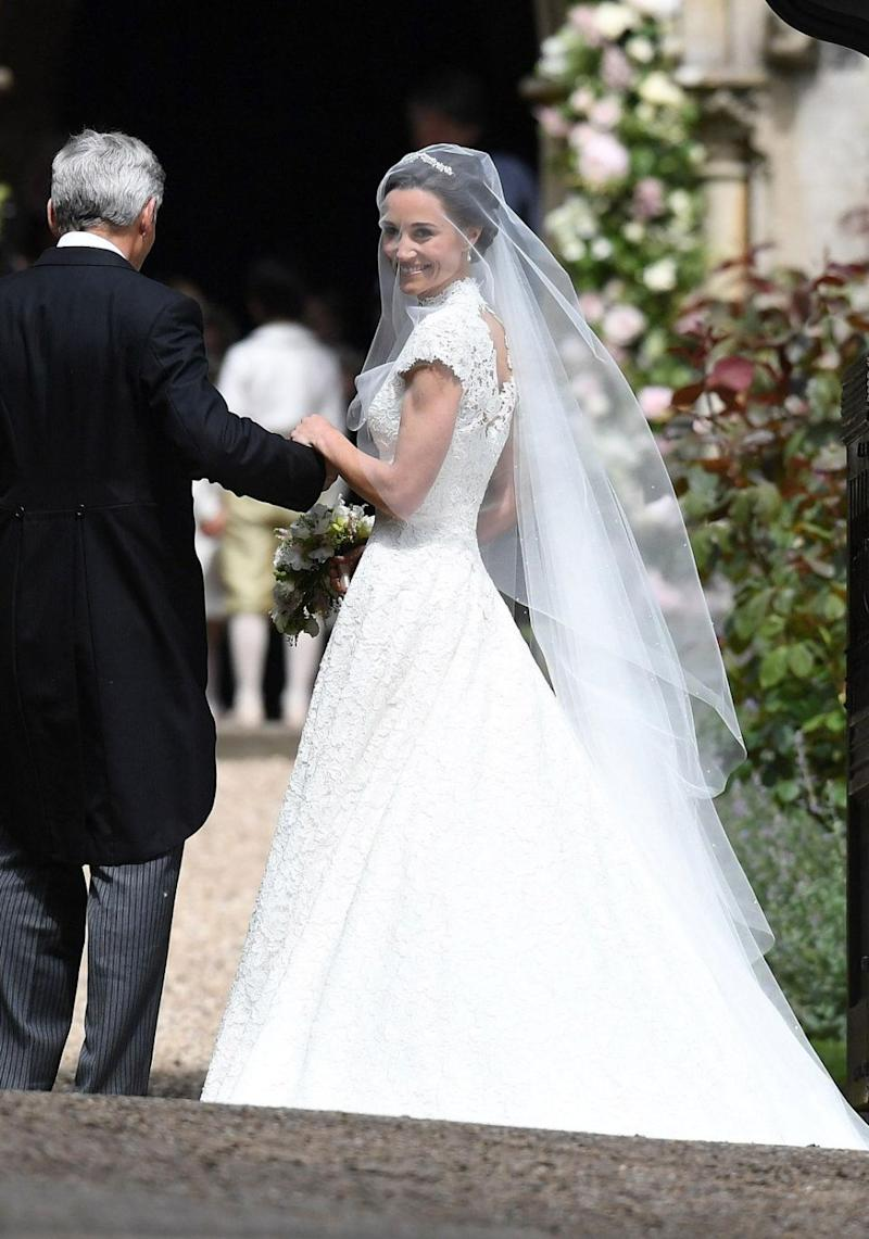 The younger sister of Duchess Kate arrived at St Mark's Church in Englefield Green, in a beautiful floor-length white gown and matching veil. Source: Getty