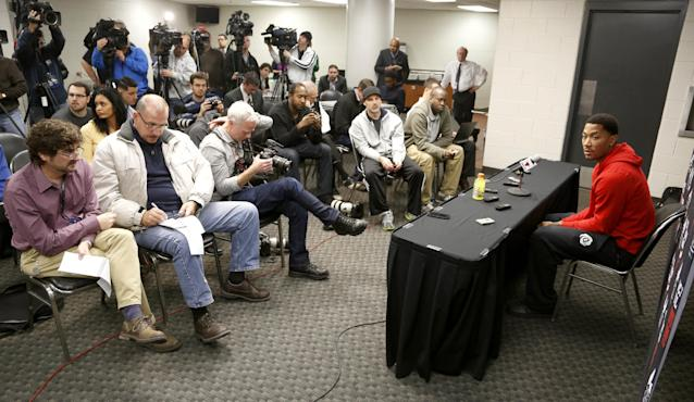 Chicago Bulls guard Derrick Rose, right, listens to a question about his injured knee during an NBA basketball news conference at the United Center Thursday, Dec. 5, 2013, in Chicago. (AP Photo/Charles Rex Arbogast)