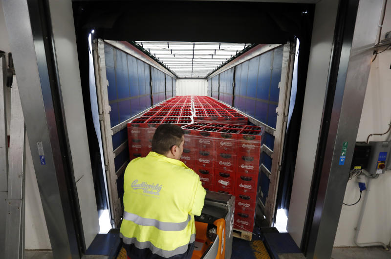 In this photo taken on Monday, March 11, 2019, a worker loads a truck with cases of beer at the Budejovicky Budvar brewery in Ceske Budejovice, Czech Republic. The Budejovicky Budvar brewery in the Czech Republic managed to survive a decades-long trademark battle over whether it could call its beer Budweiser. But now it faces another potential threat: Brexit. The United Kingdom is one of the brewer's top five markets, and like many other businesses, it's concerned about what will happen if Britain leaves the European Union without an agreement governing trade. (AP Photo/Petr David Josek)