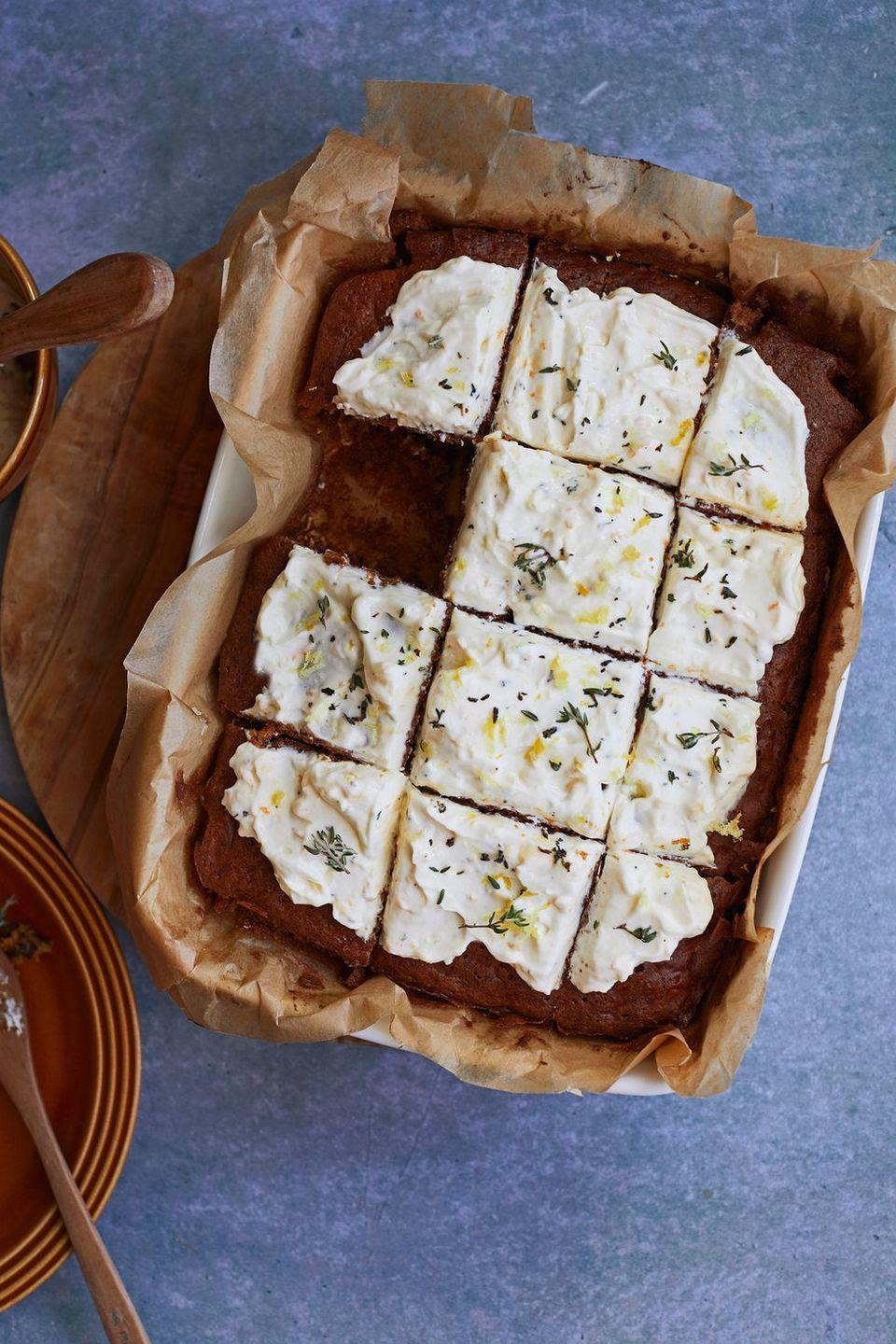 """<p><a href=""""https://www.delish.com/uk/cooking/recipes/g33521348/best-carrot-cake-recipes/"""" rel=""""nofollow noopener"""" target=""""_blank"""" data-ylk=""""slk:Carrot cake"""" class=""""link rapid-noclick-resp"""">Carrot cake</a> traybake is one of our favourite springtime <a href=""""https://www.delish.com/uk/cooking/recipes/g31433515/best-cake-recipes/"""" rel=""""nofollow noopener"""" target=""""_blank"""" data-ylk=""""slk:bakes"""" class=""""link rapid-noclick-resp"""">bakes</a> to make. The ricotta frosting is a deliciously light and tangy twist on the classic cream cheese topping. Thyme might sound unusual here but the subtle herbal flavour works perfectly with the warming spices and <a href=""""https://www.delish.com/uk/cooking/recipes/a34445804/chocolate-orange-doughnuts/"""" rel=""""nofollow noopener"""" target=""""_blank"""" data-ylk=""""slk:orange"""" class=""""link rapid-noclick-resp"""">orange</a> flavour in the cake.</p><p>Get the <a href=""""https://www.delish.com/uk/cooking/recipes/a35305446/carrot-cake-traybake/"""" rel=""""nofollow noopener"""" target=""""_blank"""" data-ylk=""""slk:Carrot Cake Traybake"""" class=""""link rapid-noclick-resp"""">Carrot Cake Traybake</a> recipe. </p>"""