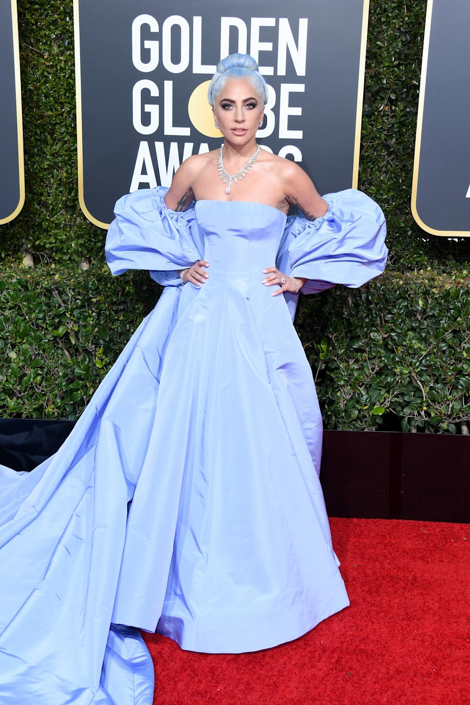 """<p>Lady Gaga has worn some questionable gowns over the years (i.e. the infamous meat dress) however the """"Star is Born"""" actress opted for a timeless Valentino gown for the 2019 awards. (Image via Getty Images)</p>"""