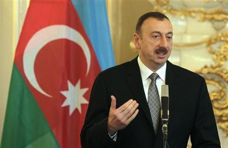 Azerbaijan's President Aliyev answers questions during a news conference in Prague