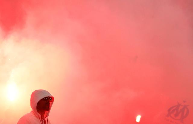 Soccer Football - Europa League Final - Olympique de Marseille vs Atletico Madrid - Groupama Stadium, Lyon, France - May 16, 2018 Marseille fans let off flares during the match REUTERS/John Sibley
