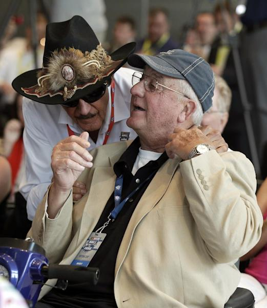 Maurice Petty, right, is congratulated by brother Richard Petty, left, after being named to the next class of inductees during an announcement at the NASCAR Hall of Fame in Charlotte, N.C., Wednesday, May 22, 2013. (AP Photo/Chuck Burton)