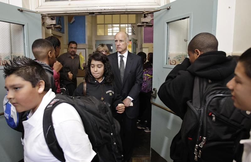 Calif. Gov. Jerry Brown tours James Lick Middle School in San Francisco, Wednesday, Aug. 22, 2012 as he campaigns supporting Proposition 30. As Brown kicked off his campaign for Proposition 30 last week, he sought to emphasize that most of the revenue from the tax increases would come from Californians who are among the wealthiest; an extra $4,500 a year for millionaires, he said. (AP Photo/Paul Sakuma)
