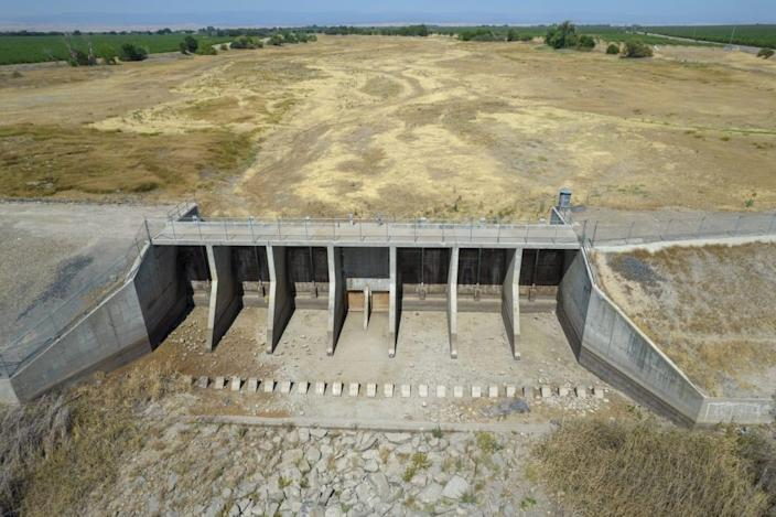 """<div class=""""inline-image__caption""""><p>The floodgates of the completely dry Berenda Reservoir in Chowchilla, California, U.S., on Monday, June 21, 2021. </p></div> <div class=""""inline-image__credit"""">Kyle Grillot/Bloomberg via Getty</div>"""