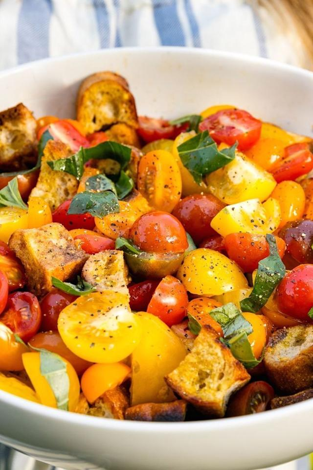 """<p>Panzan-HELL-YEA!</p><p>Get the <a href=""""https://www.delish.com/uk/cooking/recipes/a28839889/summer-panzanella-recipe/"""" target=""""_blank"""">Summer Panzanella</a> recipe.</p>"""