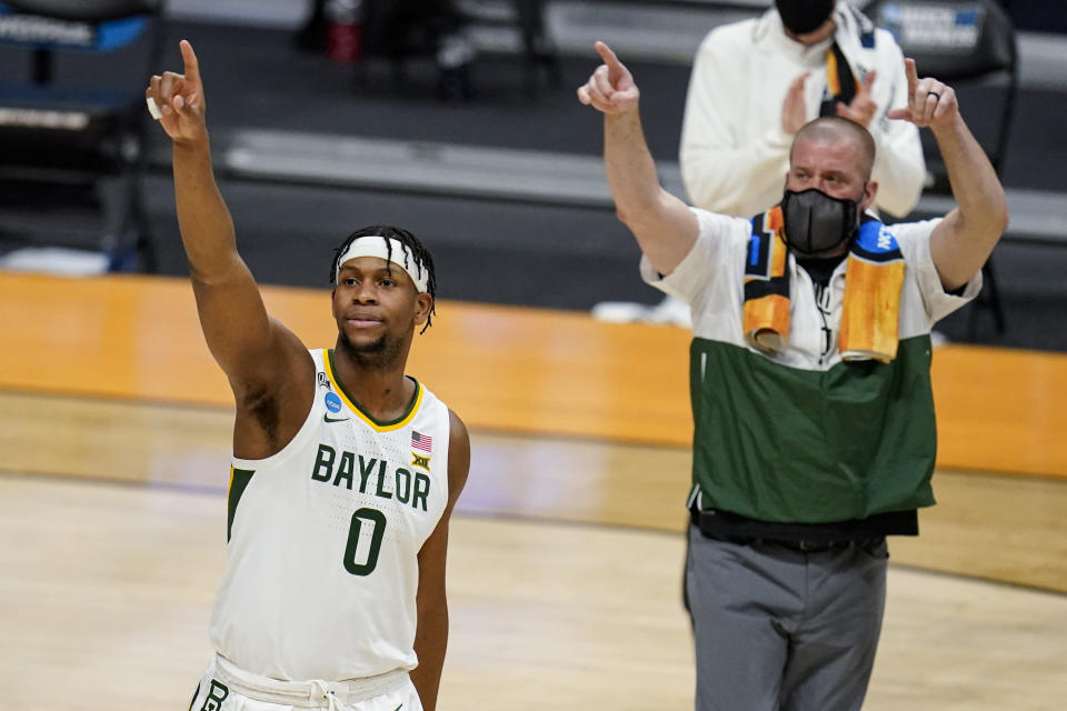 Baylor forward Flo Thamba (0) celebrates after a 76-63 win over Wisconsin in a second-round game in the NCAA men's college basketball tournament at Hinkle Fieldhouse in Indianapolis, Sunday, March 21, 2021. (AP Photo/Michael Conroy)