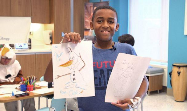 PHOTO: Kevin Joseph, a patient at New York Presbyterian Hospital shows off his portrait drawn by Olaf. (ABC News)