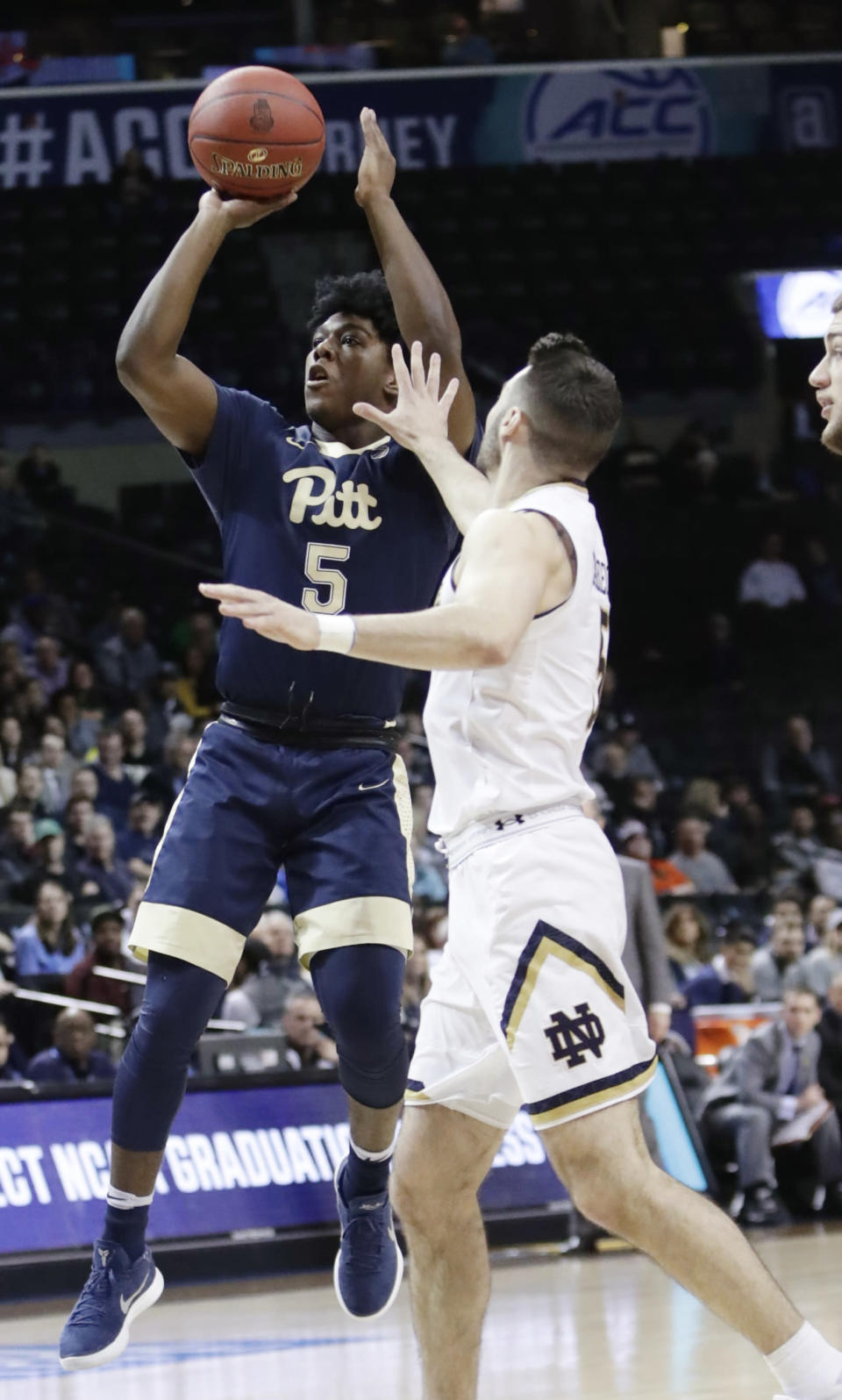 Pittsburgh's Marcus Carr (5) shoots over Notre Dame's Matt Farrell during the first half of an NCAA college basketball game in the first round of the Atlantic Coast Conference tournament Tuesday, March 6, 2018, in New York. (AP Photo/Frank Franklin II)