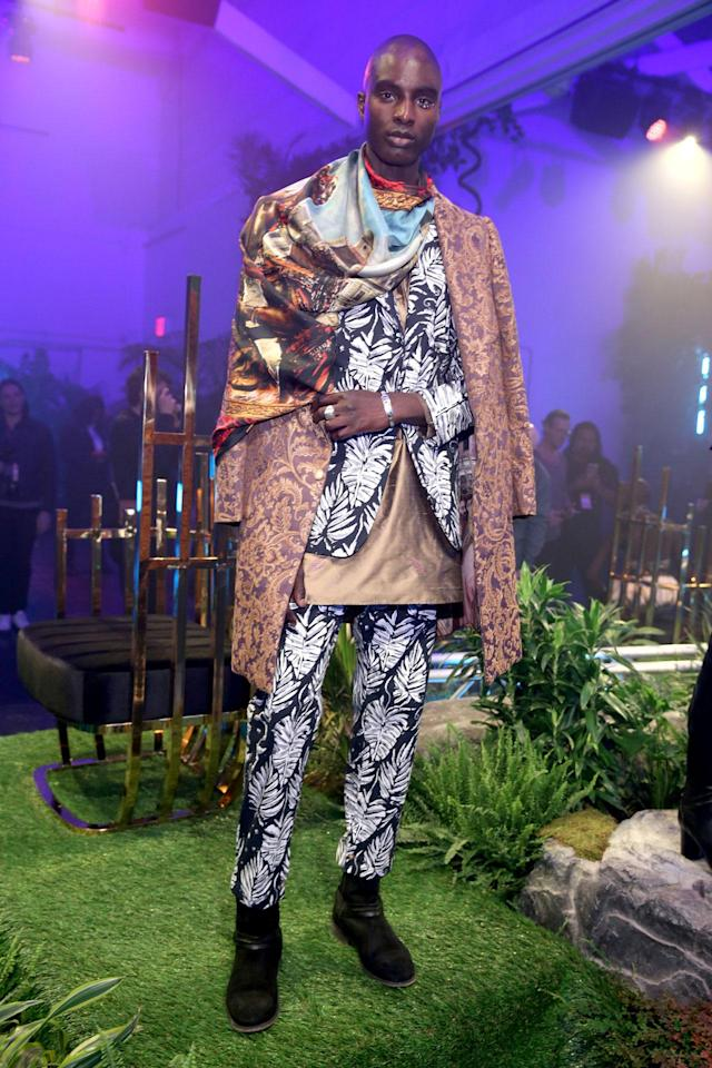 <p>Model wears a maximalist style print suit, coat and scarf design by Ikré Jones at the Black Panther Welcome to Wakanda NYFW fashion presentation. (Photo: Courtesy of Marvel Studios Black Panther/Getty) </p>