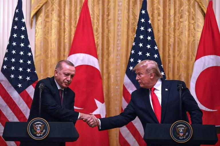 """At the White House in November 2019, Turkey's President Recep Tayyip Erdogan (L) warned that """"allegations are being used in order to dynamite our reciprocal and bilateral relations"""""""