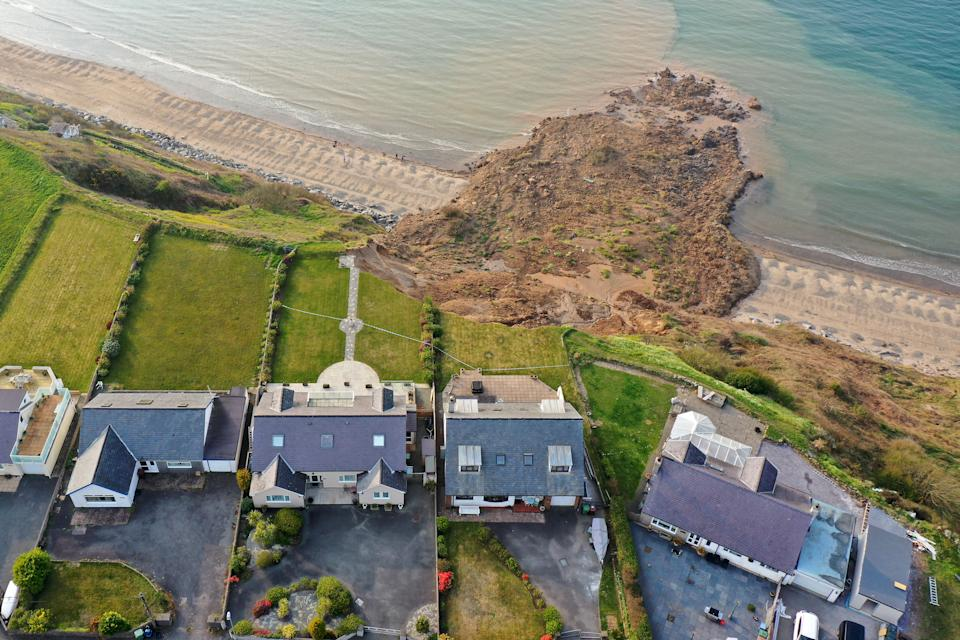 NEFYN, WALES - APRIL 21: In an aerial view houses are seen next to the cliff edge after a landslide at Nefyn Beach in Gwynedd, North Wales on April 21, 2021 in Nefyn, United Kingdom. Following the large land slip people were advised to temporarily relocate. (Photo by Christopher Furlong/Getty Images)