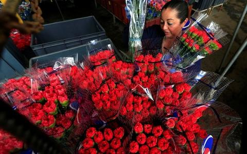Red roses bouquets for Valentine's Day - Credit: Jaime Saldarriaga/Reuters