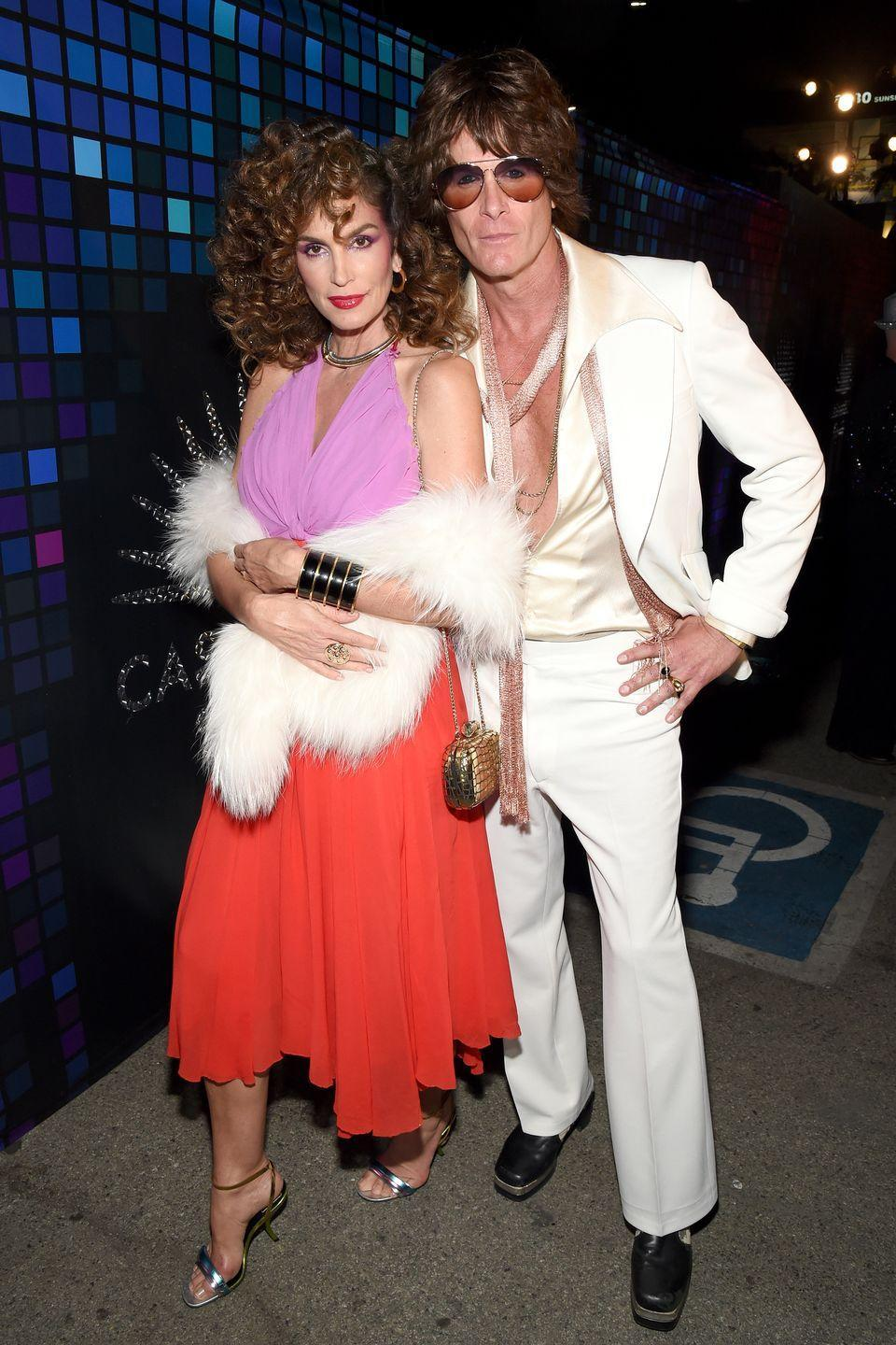 <p>Cindy Crawford and Rande Gerber in '70s costumes.</p>