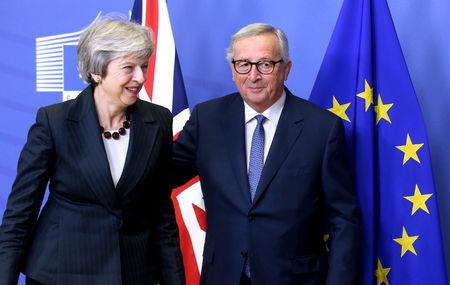 British Prime Minister Theresa May and European Commission President Jean-Claude Juncker leave to discuss draft agreements on Brexit, at the EC headquarters in Brussels, Belgium November 21, 2018.  REUTERS/Francois Walschaerts
