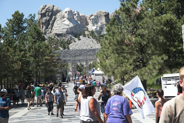 Tourists visit Mount Rushmore National Monument on July 01, 2020 in Keystone, South Dakota. President Donald Trump is expected to visit the monument and speak before the start of a fireworks display on July 3.
