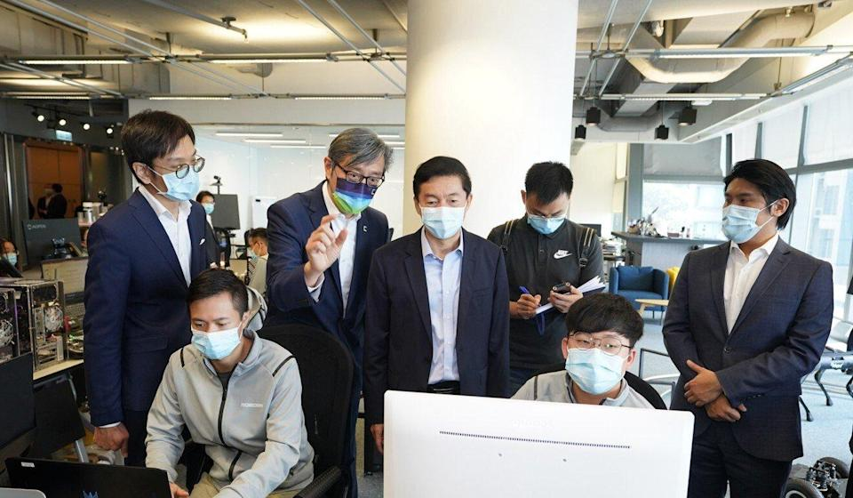 Luo Huining visits an IT company at Cyberport. Photo: Handout