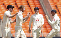 England's Ben Stokes, second left, and teammates celebrate the dismissal of India's Rohit Sharma during the second day of fourth cricket test match between India and England at Narendra Modi Stadium in Ahmedabad, India, Friday, March 5, 2021. (AP Photo/Aijaz Rahi)