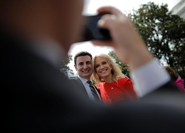 "White House counselor Kellyanne Conway poses with a guest prior to a ""celebration of America"" event on the South Lawn of the White House in Washington, U.S., June 5, 2018. The event was arranged after Trump canceled the planned visit of the Super Bowl champion Philadelphia Eagles to the White House. REUTERS/Carlos Barria"