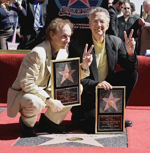 FILE - In this Feb. 28, 2007 file photo, former Doors band members Ray Manzarek, right, and Robby Krieger display the stars they received on the Walk of Fame in the Hollywood section of Los Angeles. Manzarek, the keyboardist for the Doors has died at 74. Publicist Heidi Robinson-Fitzgerald says in a news release that Manzarek died Monday, May 20, 2013, at the RoMed Clinic in Rosenheim, Germany, surrounded by his family. (AP Photo/Nick Ut, File)