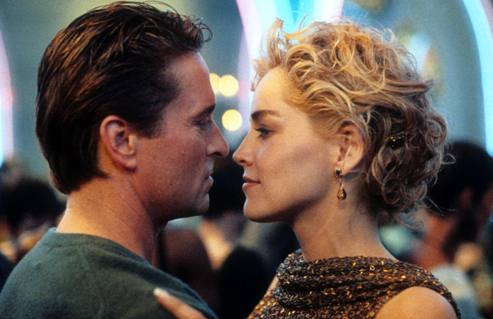 Michael Douglas and Sharon Stone dancing in scene from the film 'Basic Instinct', 1992. (Photo by TriStar/Getty Images)
