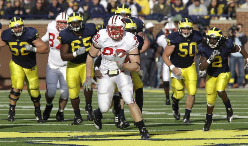 Wisconsin lineman J.J. Watt is chased by the Michigan offensive line after intercepting a deflected pass deflected during the fourth quarter of a NCAA college football game in Ann Arbor, Mich., Saturday, Nov. 20, 2010. (AP Photo/Carlos Osorio)