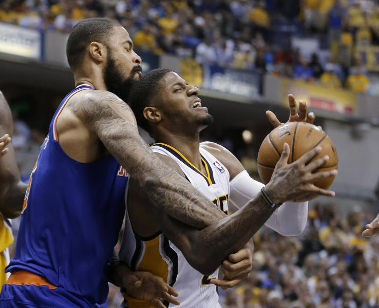 Indiana Pacers' Paul George is fouled by New York Knicks' Tyson Chandler during the second half of Game 4 of an Eastern Conference semifinal NBA basketball playoff series, on Tuesday, May 14, 2013, in Indianapolis. Indiana defeated New York 93-82. (AP Photo/Darron Cummings)