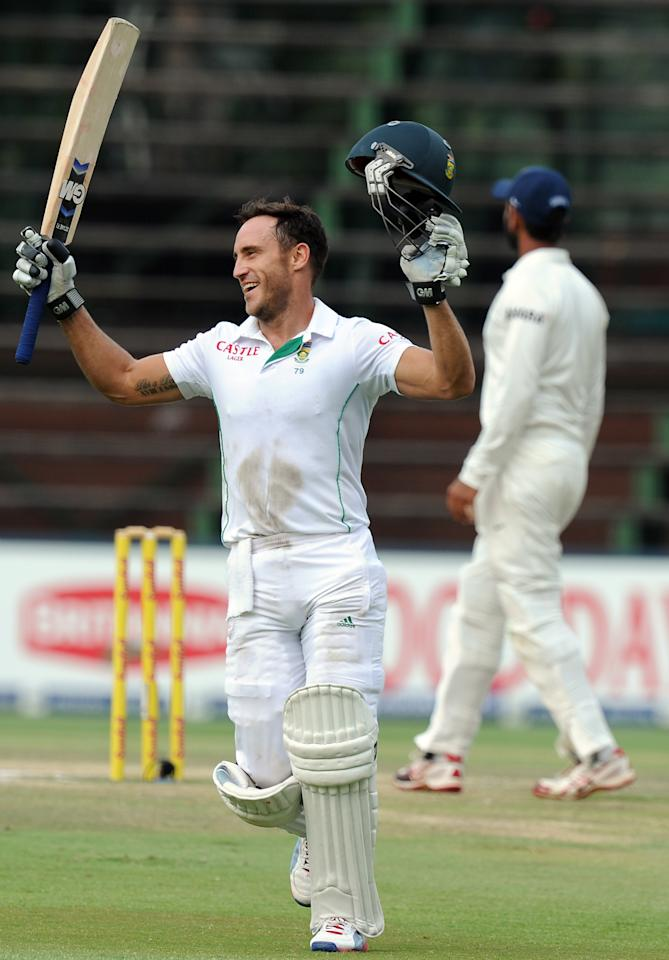 South African batsman Faf du Plessis celebrates his century on the fifth day of a first cricket Test match between South Africa and India in Johannesburg at Wanderers Stadium on December 22, 2013. AFP PHOTO / STR