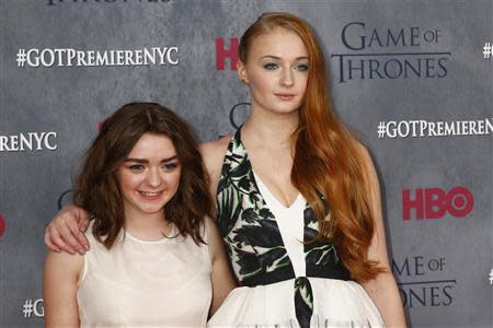"""Cast members Maisie Williams and Sophie Turner arrive for the season four premiere of the HBO series """"Game of Thrones"""" in New York"""