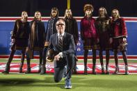 Designer Tommy Hilfiger poses with models before presenting his Fall/Winter 2015 collection at the New York Fashion Week February 16, 2015. Shunning the traditional catwalk, Mr. Hilfiger instead presented his collection on a mock American Football field. REUTERS/Andrew Kelly (UNITED STATES - Tags: FASHION ENTERTAINMENT)