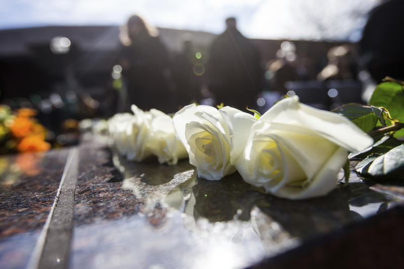 FILE - In this Nov. 14, 2019, file photo, roses are placed along the edge of the Memorial Fountain honoring the 75 lives lost in the 1970 plane crash as Marshall University hosts its 49th annual Memorial Fountain Ceremony in Huntington, W.Va. Marshall and East Carolina will open the 2020 football season a week earlier to accommodate a national television broadcast to mark the 50th anniversary of the worst disaster in U.S. sports history. The schools announced Thursday, Feb. 20, 2020, that the game originally scheduled for Sept. 5 in Greenville, N.C., will now be played Aug. 29.(Sholten Singer/The Herald-Dispatch via AP, File)