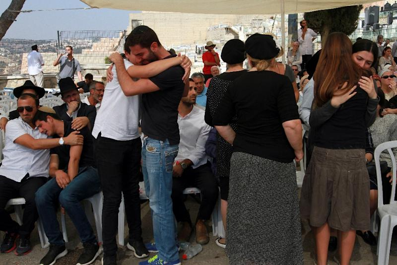 Friends and relatives mourn during the funeral of 24-year-old Israeli-Canadian soldier Aaron Bennett, who was killed when a Palestinian man attacked him and his family with a knife in Jerusalem's Old City (AFP Photo/Gil Cohen-Magen)