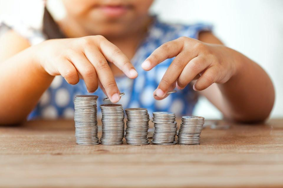 Child with coin stacks.