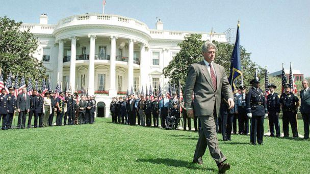 PHOTO: President Bill Clinton walks on the South Lawn of the White House, April 14, 1994, where he discussed his crime bill package with mayors and law enforcement officials. (Dennis Cook/AP)