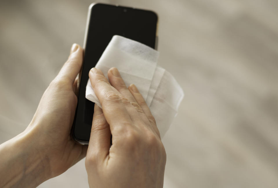 Make sure you're regularly cleaning your phone. (Photo: Getty)