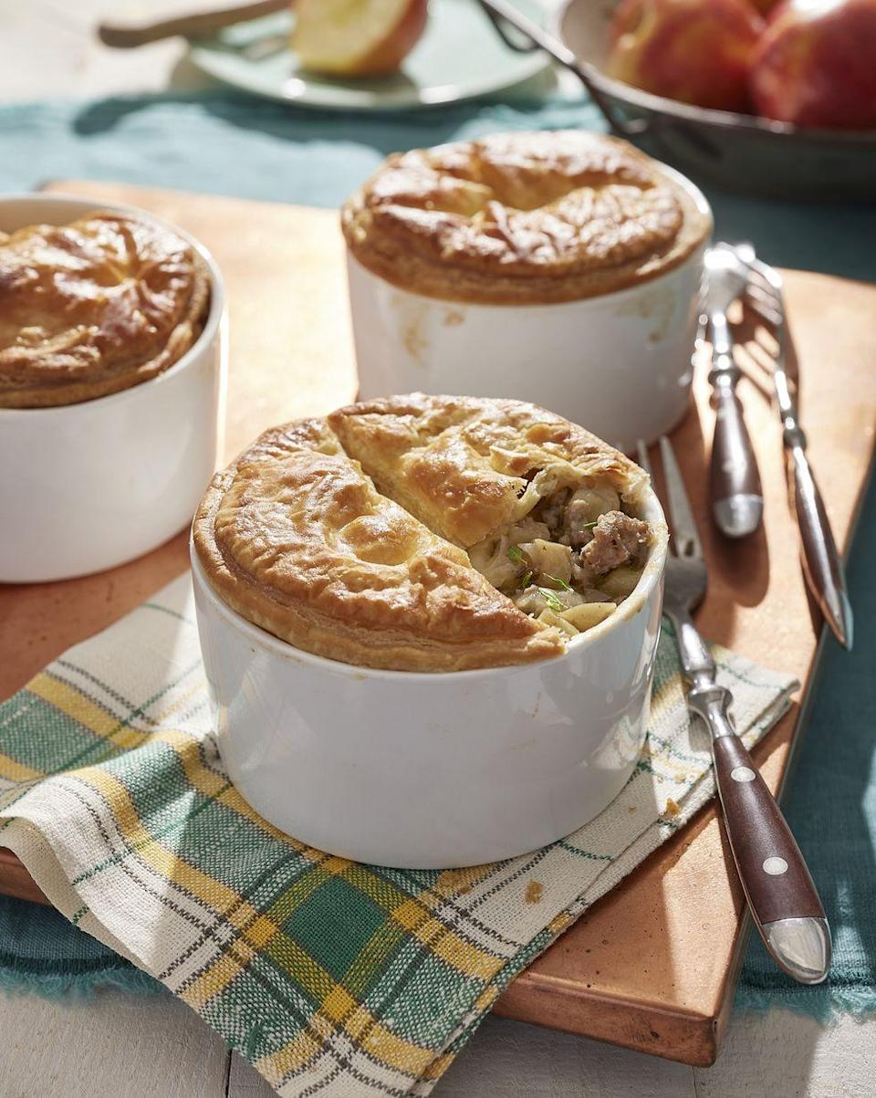 """<p>Pies don't have to just be for dessert! This savory apple pie is elegantly served in individual portions.</p><p><strong><a href=""""https://www.countryliving.com/food-drinks/a37272602/sausage-and-apple-pies-recipe/"""" rel=""""nofollow noopener"""" target=""""_blank"""" data-ylk=""""slk:Get the recipe"""" class=""""link rapid-noclick-resp"""">Get the recipe</a>.</strong> </p>"""