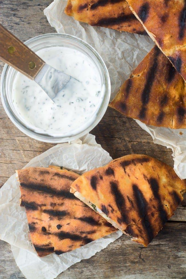 """<p>Yes, yes and YES. Load up that charcoaled pita with this minty lamb for a crispy and juicy dinner. </p><p>Get the <a href=""""https://theviewfromgreatisland.com/spiced-lamb-pita-burgers-recipe/"""" rel=""""nofollow noopener"""" target=""""_blank"""" data-ylk=""""slk:Spiced Lamb Pita Burgers"""" class=""""link rapid-noclick-resp"""">Spiced Lamb Pita Burgers</a> recipe.</p><p>Recipe from <a href=""""https://theviewfromgreatisland.com/"""" rel=""""nofollow noopener"""" target=""""_blank"""" data-ylk=""""slk:The View From Great Island"""" class=""""link rapid-noclick-resp"""">The View From Great Island</a>. </p>"""