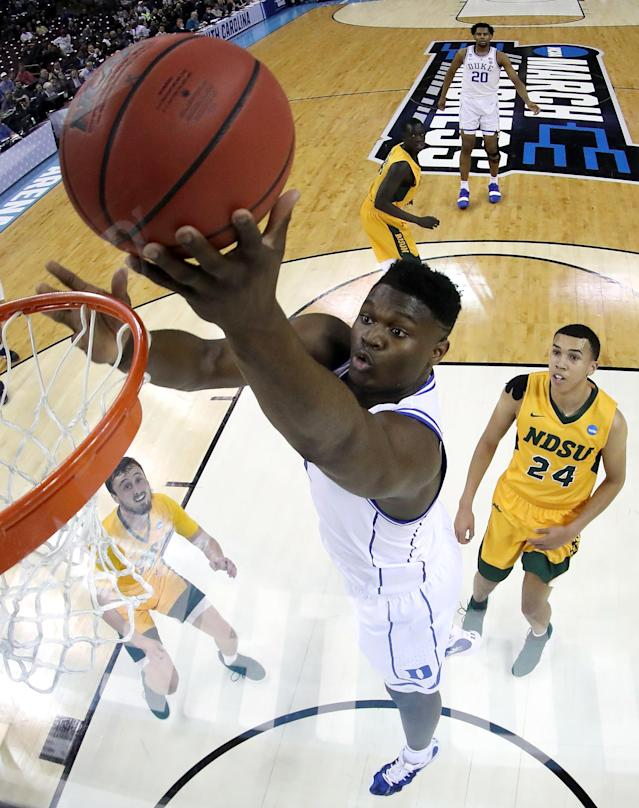 <p>Zion Williamson #1 of the Duke Blue Devils attempts a shot against the North Dakota State Bison in the second half during the first round of the 2019 NCAA Men's Basketball Tournament at Colonial Life Arena on March 22, 2019 in Columbia, South Carolina. (Photo by Kevin C. Cox/Getty Images) </p>